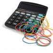 Calculator and rubber bands — Stock Photo