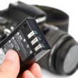 Battery and DSLR - Stock Photo