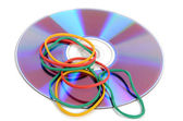Rubber bands and DVD — Stock Photo