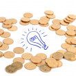 Light bulb and coins — Foto de Stock