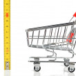 Shopping cart and tape line — Stock Photo