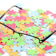 Eye glasses and puzzle — Stockfoto