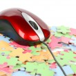 Computer mouse and puzzle — Stock Photo