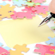 Note paper and puzzle with pen — Stock Photo #11953108