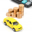 Toy car and calculator with coin — Stockfoto
