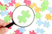 Puzzle and magnifier — Foto de Stock