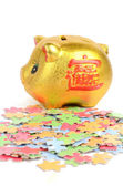 Puzzle and piggy bank — Stock Photo
