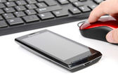Smart phone and keyboard with computer mouse — Stock Photo