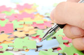Pen and puzzle — Stockfoto