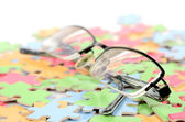Eye glasses and puzzle — Stock Photo