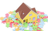 Puzzle and model house — Stock Photo