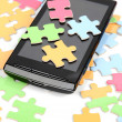 Stock Photo: Puzzle and smart phone