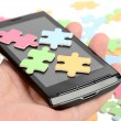 Puzzle and smart phone — Stock Photo