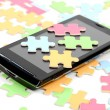 Puzzle and smart phone — Stock Photo #12011362