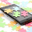 Puzzle and smart phone — Stock Photo #12011369