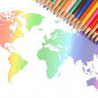 World map and color pencils — Stockfoto