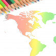 World map and color pencils — Stock Photo