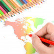 World map and color pencils — Stock Photo #12013721