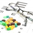 Stock Photo: Medicine and eye chart