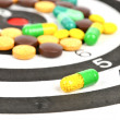 Royalty-Free Stock Photo: Dart board and medicine