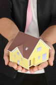 Model house in hand — Stock Photo