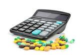 Medicine and calculator — Stockfoto