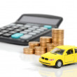 Stock Photo: Toy car and coin with calculator