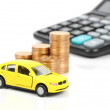 Toy car and coin with calculator — Stock Photo