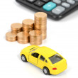 Toy car and coin with calculator — Stock Photo #12043592