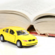 Toy car and dictionary - Stock Photo