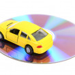 DVD and toy car - Zdjęcie stockowe