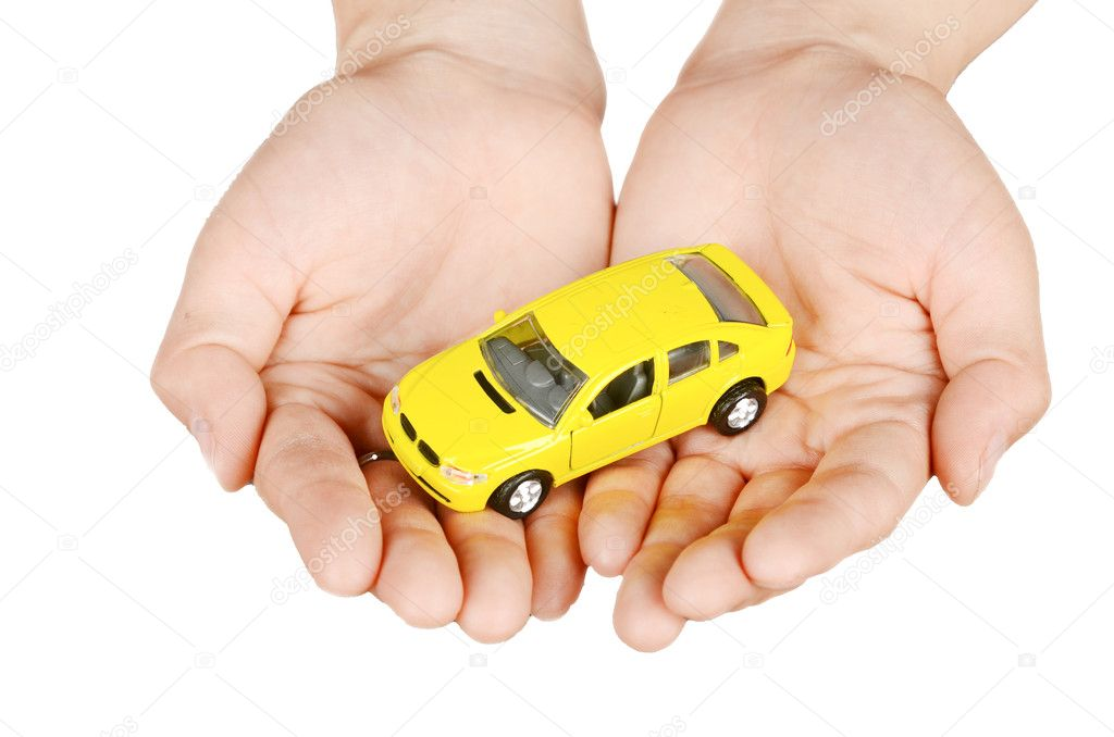 Toy car in hand on white background — Stock Photo #12043957