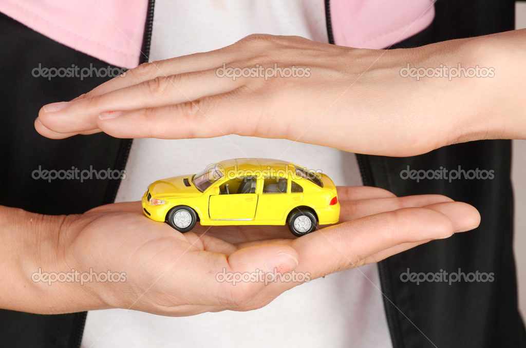Toy car in hand on white background — Stock Photo #12044009
