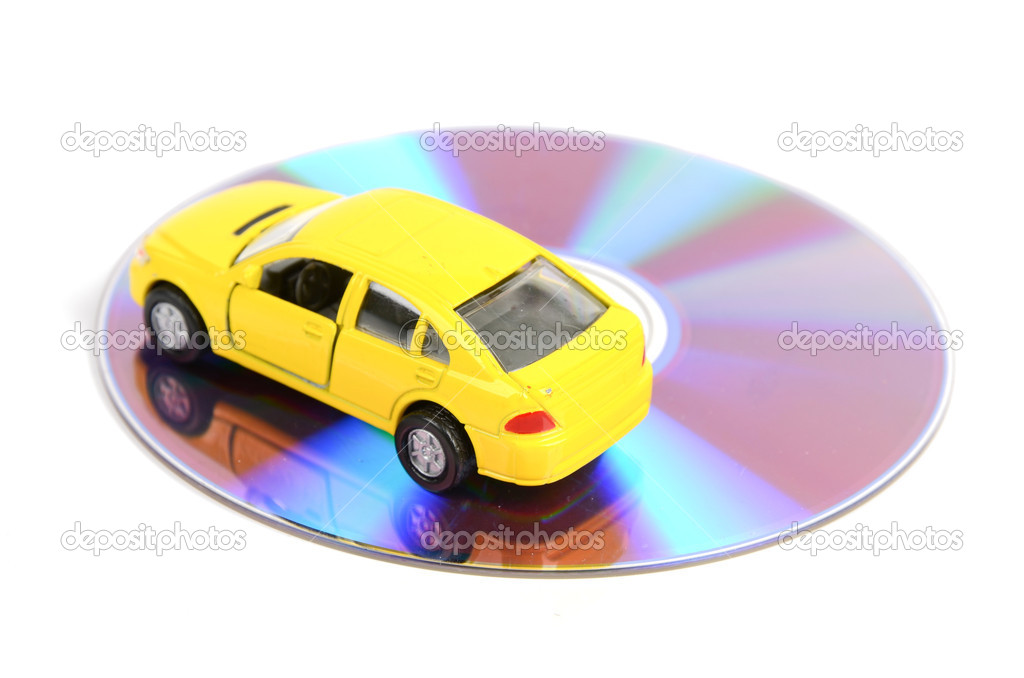 DVD and toy car on white background — Foto Stock #12045374