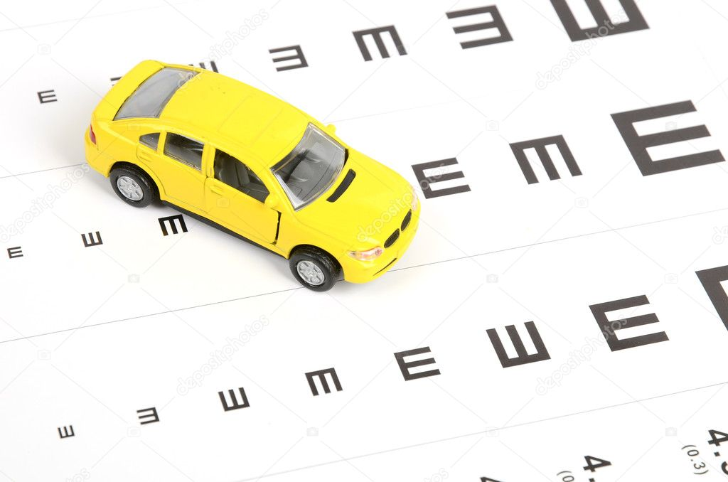 Toy car and eyesight chart — Stock Photo #12045629