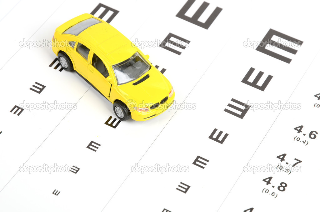 Toy car and eyesight chart — Stock Photo #12045637