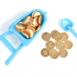 Toy pushcart and coins — Stock Photo