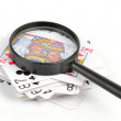 Poker and magnifier — Stock Photo