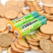 Batteries and coins — Stock Photo