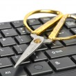 Stock Photo: Scissors and computer keyboard