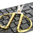 Scissors and computer keyboard — Stock Photo