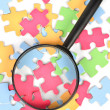 Puzzle and magnifier — Stock Photo