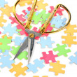 Puzzle and scissors - Stock Photo