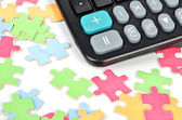 Puzzle and calculator — Stock Photo