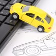 Stock Photo: Computer keyboard and car blueprint