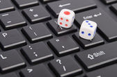 Dice rolled on computer mouse — Stock Photo