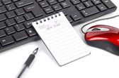 Notepad and pen on keyboard — Stock Photo