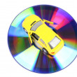 Toy car and DVD — Stock Photo