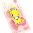 Stock Photo: Toy car and money