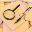 Documents and magnifier with pen — Stock Photo